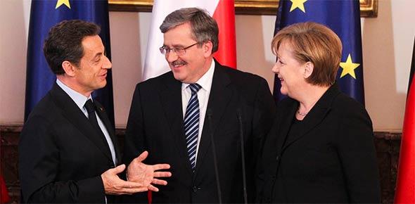 Prezydenci Francji (N. Sarkozy) i Polski (B. Komorowski) z niemiecką kanclerz (A. Merkel). Zdjęcie: prezydent.pl